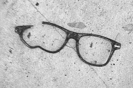 Broken glasses on the ground in need of repair